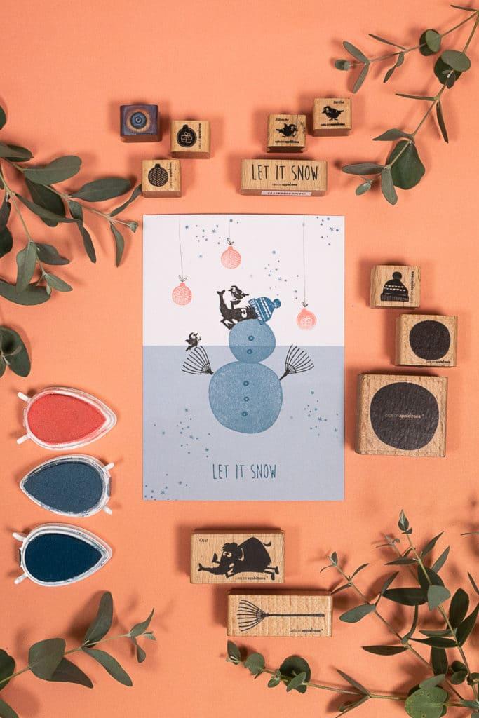 Gestempelte Karte mit Mammut Ove und einem Schneemann