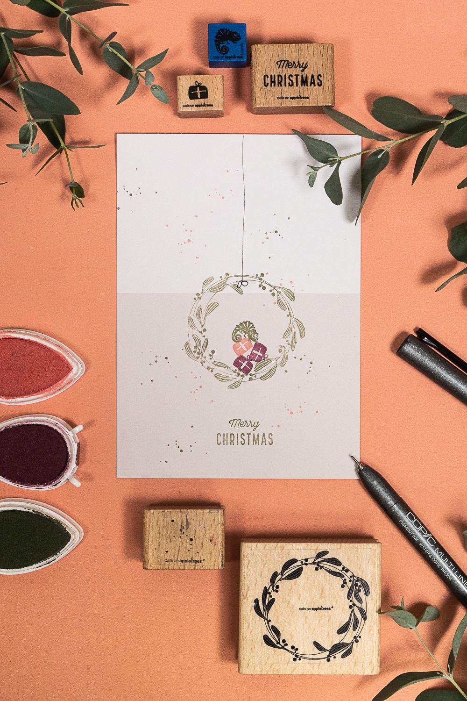 Gestempelte Karte mit Chamäleon Lorelis und einem Mistelkranz